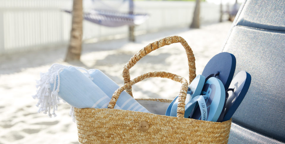 beach tote with flip flops and towels